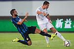 (R) Cristiano Ronaldo of Real Madrid CF being followed by (L) Martin Motoya of FC Internazionale Milanoduring the FC Internazionale Milano vs Real Madrid as part of the International Champions Cup 2015 at the Tianhe Sports Centre on 27 July 2015 in Guangzhou, China. Photo by Hendrik Frank / Power Sport Images