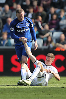 (L-R) Wayne Rooney of Everton helps Andy King of Swansea City to get to his feet during the Premier League match between Swansea City and Everton at The Liberty Stadium, Swansea, Wales, UK. Saturday 14 April 2018