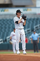 Birmingham Barons starting pitcher Lincoln Henzman (15) looks to his catcher for the sign against the Pensacola Blue Wahoos at Regions Field on July 7, 2019 in Birmingham, Alabama. The Barons defeated the Blue Wahoos 6-5 in 10 innings. (Brian Westerholt/Four Seam Images)