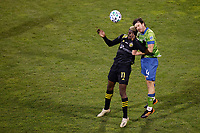 COLUMBUS, OH - DECEMBER 12: Gyasi Zardes #11 of Columbus Crew battles for the ball against Gustav Svensson #4 of Seattle Sounders FC during a game between Seattle Sounders FC and Columbus Crew at MAPFRE Stadium on December 12, 2020 in Columbus, Ohio.