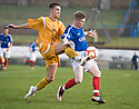 DUMBARTON'S RYAN FINNIE AND COWDENBEATH'S MARC MCKENZIE CHALLENGE FOR THE BALL