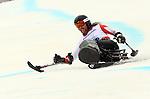 Caleb Brousseau, Sochi 2014 - Para Alpine Skiing // Para-ski alpin.<br /> Caleb Brousseau competes in the men's Super G, sitting event // Caleb Brousseau participe au Super G masculin, épreuve assise. 09/03/2014.
