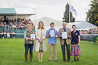VOLUNTEER AWARDS: (L-R) Sue Bowie; Alex Holman; Barry Kew: CCI4* SHOWJUMPING: 2014 GBR-Land Rover Burghley Horse Trial (Sunday 7 September) CREDIT: Libby Law COPYRIGHT: LIBBY LAW PHOTOGRAPHY - NZL