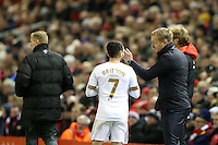 Swansea City Manager Garry Monk issues instructions as he stands in the technical area Leon Britton during a break in play during the Barclays Premier League Match between Liverpool and Swansea City played at Anfield, Liverpool on 29th November 2015