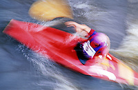 Blurred motion image of a kayaker in motion.