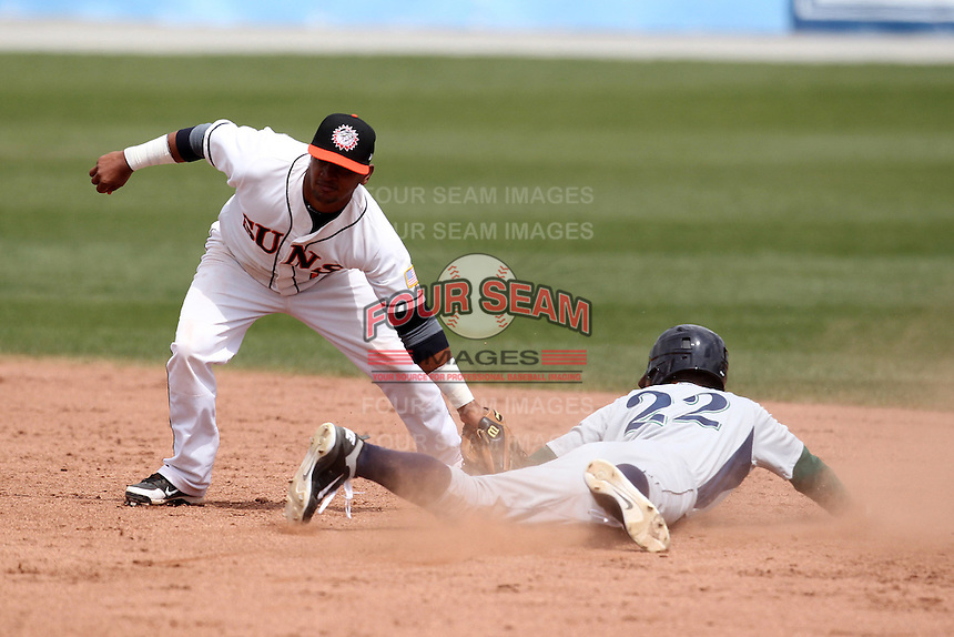 Hagerstown Suns second baseman Hendry Jimenez #7 tags out Justin Gominsky #22 on a steal attempt during a game against the Lexington Legends at Municipal Park on April 11, 2012 in Hagerstown, Maryland.  Lexington defeated Hagerstown 3-0.  (Mike Janes/Four Seam Images)