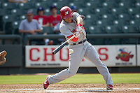 Memphis Redbirds outfielder Thomas Pham (27) swings and misses during the first game of a Pacific Coast League doubleheader against the Round Rock Express on August 3, 2014 at the Dell Diamond in Round Rock, Texas. The Redbirds defeated the Express 4-0. (Andrew Woolley/Four Seam Images)