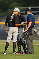 Eddie Gamboa (7) of the Bluefield Orioles exchanges baseballs with home plate umpire Jeff Morrow at Burlington Athletic Park in Burlington, NC, Saturday, July 26, 2008. (Photo by Brian Westerholt / Four Seam Images)