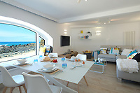 BNPS.co.uk (01202) 558833. <br /> Pic: KnightFrank/BNPS<br /> <br /> Pictured: Open plan living with an incredible view. <br /> <br /> The ultimate room with a view...<br /> <br /> A former fish cellar that is now an idyllic waterfront home overlooking a famous Cornish beach is on the market for £930,000.<br /> <br /> The ground floor apartment is in a prime frontline position with exceptional panoramic views over Porthmeor Beach and out to sea.<br /> <br /> Estate agent Christopher Bailey said the window in the reception space is like having your own live television screen looking out on the action of the beach.<br /> <br /> It has been designed and renovated to an exceptionally high standard and the immaculate flat is currently rented out for short holiday let, making about £40,000 profit a year.