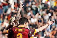 Calcio, Serie A: Roma vs Napoli. Roma, stadio Olimpico, 25 aprile 2016.<br /> Roma's Radja Nainggolan, left, celebrates with teammates Diego Perotti, center, and Miralem Pjanic, after scoring the winning goal during the Italian Serie A football match between Roma and Napoli at Rome's Olympic stadium, 25 April 2016. Roma won 1-0.<br /> UPDATE IMAGES PRESS/Riccardo De Luca