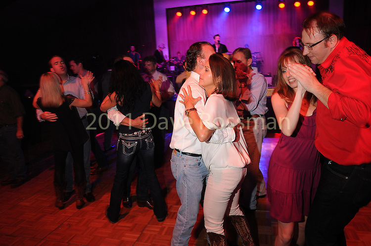 Guests dance at the Nature Conservancy's Nature Rocks  Gala at the Houston Polo Club Thursday Oct. 22,2015.(Dave Rossman photo)