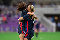 ORLANDO CITY, FL - FEBRUARY 21: Christen Press #23 and Lindsey Horan #9 of the USWNT celebrate a goal during a game between Brazil and USWNT at Exploria Stadium on February 21, 2021 in Orlando City, Florida.