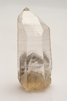Quartz crystal with phantom. Brazil. A phantom is a quartz crystal which grows over an earlier crystal, usually due to a change in growth conditions causing a stoppage or interruption. The  original crystal may have had deposition of fine-grained mineral matter, micro-bubbles, or even rock dust collect on its face during the interruptive period. Such inclusions further highlight the phantom.