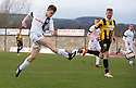 Ayr Utd's Alan Forrest scores their fifth goal.