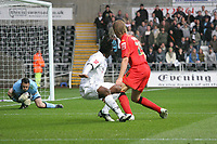 Pictured: Jason Scotland of Swansea City has a shot at goal<br />