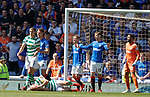 12.05.2019 Rangers v Celtic: Scott Brown down holding his face as Jon Flanagan looks around