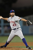 R.A. Dickey #43 of the New York Mets pitches against the Los Angeles Dodgers at Dodger Stadium on June 29, 2012 in Los Angeles, California. New York defeated Los Angeles 9-0. (Larry Goren/Four Seam Images)