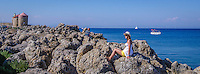 Travel Art Print Photograph of a beautiful seaport located in Rhodes Greece. A picturesque scenic of people enjoying the beautiful blue seascape on a clear and sunny day.