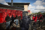 FC United of Manchester 0 Benfica 1, 29/05/2015. Broadhurst Park, Stadium Opening. Fans gathering outside a turnstile at Broadhurst Park, Manchester, the new home of FC United of Manchester before the club's match against Benfica, champions of Portugal, which marked the official opening of their new stadium. FC United Manchester were formed in 2005 by fans disillusioned by the takeover of Manchester United by the Glazer family from America. The club gained several promotions and played in National League North in the 2015-16 season, but lost this match 1-0. Photo by Colin McPherson.