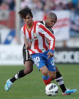 Atletico de Madrid's Oliver Torres (l) and Granada's Yacine Brahimi during La Liga match.April 14,2013. (ALTERPHOTOS/Acero)
