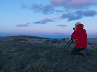 Photographer Fraser Bliss approaches Cabo Espiritu Santo lighthouse at sunset from the barrens of Tierra del Fuego in Patagonia, Chile.