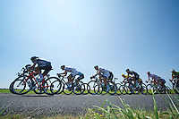 peloton stretching and breaking into echelons, lead by Team OmegaPharma-Quickstep. Overall riders trying to hang on.<br /> <br /> Tour de France 2013<br /> stage 13: Tours to Saint-Amand-Montrond, 173km