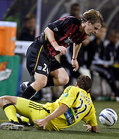 The MetroStars' Eddie Gaven attempts to get past a fallen Manny Lagos of the Crew. The Columbus Crew and the MetroStars played to a 1-1 tie in regular season MLS action on Saturday October 9, 2004 at Giant's Stadium, East Rutherford, NJ..