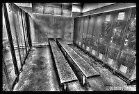 Locker room with lockers and benches in black and white/HDR