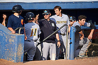 Trenton Thunder coach JD Closser (jacket) and Lane Adams (right) congratulate Mark Payton (11) after scoring a run during the first game of a doubleheader against the Hartford Yard Goats on June 1, 2016 at Sen. Thomas J. Dodd Memorial Stadium in Norwich, Connecticut.  Trenton defeated Hartford 4-2.  (Mike Janes/Four Seam Images)