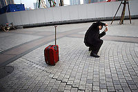 CHINA. Shanghai. A tourist taking pictures in the Pudong area. Shanghai is a sprawling metropolis or 15 million people situated in south-east China. It is regarded as the country's showcase in development and modernity in modern China. This rapid development and modernization, never seen before on such a scale has however spawned countless environmental and social problems. 2008.