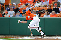 Virginia Cavaliers center fielder Brandon Downes #10 runs to first during a game against the Clemson Tigers at Doug Kingsmore Stadium on March 15, 2013 in Clemson, South Carolina. The Cavaliers won 6-5.(Tony Farlow/Four Seam Images).
