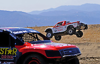 Jun. 26, 2009; Lake Elsinore, CA, USA; LOORRS unlimited 2 driver Rodrigo Ampudia (right) jumps during qualifying. Mandatory Credit: Mark J. Rebilas-