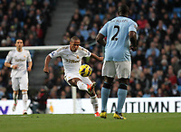 Barclays Premier League, Man City (blue) V Swansea City (white) Etihad Stadium, 27/10812<br /> Pictured: Wayne Routledge with some skill looked a threat on the left wing<br /> Picture by: Ben Wyeth / Athena Picture Agency