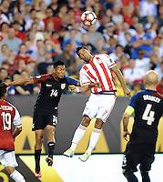 Philadelphia, PA - June 11, 2016: USA defender Michael Orozco (14) and Paraguay forward Jorge Benítez (7) during a Copa America Centenario Group A match between United States (USA) and Paraguay (PAR) at Lincoln Financial Field.