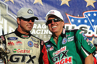 Sept. 5, 2011; Claremont, IN, USA: NHRA funny car driver John Force (right) celebrates with his teammate Mike Neff after he won the US Nationals at Lucas Oil Raceway. Mandatory Credit: Mark J. Rebilas-