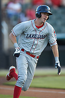 McCarthy Tatum (28) of the Lakewood BlueClaws hustles down the first base line against the Kannapolis Intimidators at Kannapolis Intimidators Stadium on July 18, 2019 in Kannapolis, North Carolina. The Intimidators defeated the BlueClaws 7-1. (Brian Westerholt/Four Seam Images)