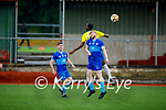 Max Mugabe of Classic and Ross Drummond of Dingle Bay Rovers tussle in the air for possession in the Denny KDL Challenge Cup