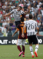 Calcio, Serie A: Roma vs Juventus. Roma, stadio Olimpico, 30 agosto 2015.<br /> Juventus' Stefano Sturaro, top left, and Roma's Lucas Digne jump for the ball during the Italian Serie A football match between Roma and Juventus at Rome's Olympic stadium, 30 August 2015.<br /> UPDATE IMAGES PRESS/Isabella Bonotto
