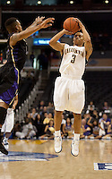California's Jerome Randle (3) takes the jump shot against Washington's Isaiah Thomas. The Washington Huskies defeated the California Golden Bears 79-75 during the championship game of the Pacific Life Pac-10 Conference Tournament at Staples Center in Los Angeles, California on March 13th, 2010.