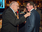 Former HISD Superintendent Billy Reagan, left, greets current Superintendent Dr. Terry Grier, right, during the State of the Schools luncheon at the Hilton of the Americas, February 26, 2014.