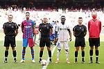 Spanish referee Pablo Gonzalez Fuertes with FC Barcelona's captain Sergio Busquets and Getafe CF's captain Djene Dakonam during La Liga match. August 29, 2021. (ALTERPHOTOS/Acero)