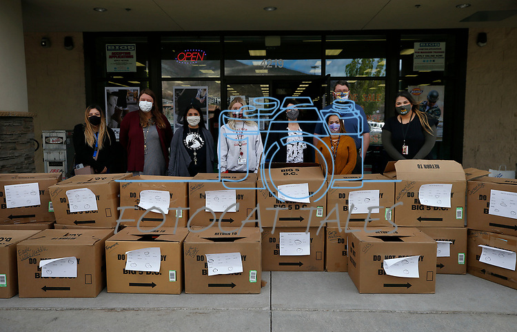 School district representatives pose with more than 200 pairs of shoes being distributed during the Step into Spring program through the McKinney-Vento program at the Carson City School District, in Carson City, Nev., on Tuesday, April 27, 2021.<br /> Photo by Cathleen Allison