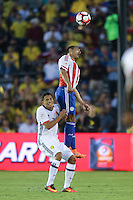Pasadena, CA - Tuesday June 07, 2016: Paraguay defender Paulo Da Silva (14) and Colombia forward Carlos Bacca (7) during a Copa America Centenario Group A match between Colombia (COL) and Paraguay (PAR) at Rose Bowl Stadium.