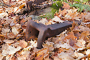 Logging era artifacts at logging Camp 6 of the abandoned Beebe River Railroad (1917-1942) in Sandwich, New Hampshire. This object is believed to be the coupler pocket for a link and pin style coupler (connected the log railroad cars to one another).  Artifacts, such as this coupler pocket, are protected, and the removal of historical artifacts from federal lands without a permit is a violation of federal law.