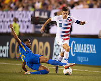 PHILADELPHIA, PA - JUNE 30: Shermaine Martina #15 tackles Christian Pulisic #10 during a game between Curacao and USMNT at Lincoln Financial Field on June 30, 2019 in Philadelphia, Pennsylvania.