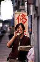 Man using public phone in Fuzhou, China. .