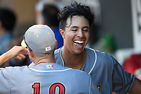 Designated hitter Mark Vientos (13) of the Columbia Fireflies, playing as the Chicharrones de Columbia, gets a hug after hitting the first inside-the-park home run in the stadium's history in a game against the Charleston RiverDogs on Friday, July 12, 2019 at Segra Park in Columbia, South Carolina. The RiverDogs won, 4-3 in 10 innings. (Tom Priddy/Four Seam Images)