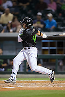 J.B. Shuck (30) of the Charlotte Knights follows through on his swing against the Columbus Clippers at BB&T BallPark on May 3, 2016 in Charlotte, North Carolina.  The Clippers defeated the Knights 8-3.  (Brian Westerholt/Four Seam Images)