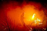 A Madrid Volunteer firefighter works in El cubillo de Uceda during a forest fire near Guadalajara, on August 11, 2012 (c) Pedro ARMESTRE