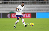 ORLANDO CITY, FL - JANUARY 31: Andres Perea #8 of the United States passes off the ball during a game between Trinidad and Tobago and USMNT at Exploria stadium on January 31, 2021 in Orlando City, Florida.